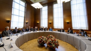 General view prior to the start of the two days of closed-door nuclear talks on Tuesday, Oct. 15, 2013 at the United Nations offices in Geneva, Switzerland. (AP Photo/Fabrice Coffrini, pool)