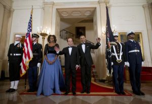 Photo by: Pablo Martinez Monsivais First Lady Michelle Obama and President Barack Obama with French President Francois Hollande, center, pose at the Grand Staircase as they arrive for a State Dinner at the White House in Washington, Tuesday, Feb. 11, 2014. (AP Photo/Pablo Martinez Monsivais)